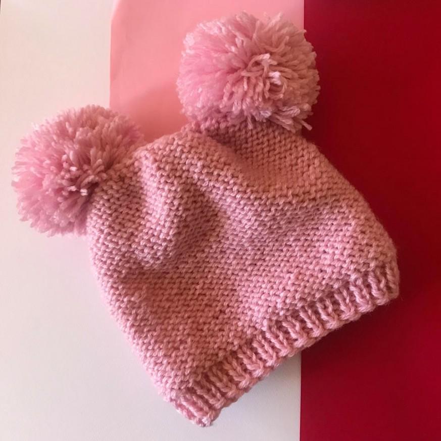 Дамска зимна шапка Бонбон с 50% вълна с 2 красиви помпона в розов цвят